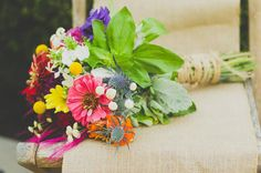 Multicolored bouquet from photo shoot with zinnias, feverfew and assorted foliage.