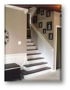 Stairs, pics, wainscoting, colors.  I would have gone with a dark bamboo floor though...