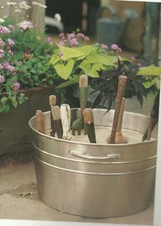 Recycle and Reuse: Creative Storage Ideas for Your Garden Shed keep a bucket filled with sand with a little oil mixed in for sharp, rust free tool storage.keep a bucket filled with sand with a little oil mixed in for sharp, rust free tool storage. Shed Organization, Shed Storage, Storage Ideas, Craft Storage, Small Garden Tool Storage, Storing Garden Tools, Container Gardening, Gardening Tips, Organic Gardening