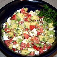 Avocado Feta Salsa - Chopped Tomatoes, Avocado, Red Onion, Oregano, Garlic, Feta, Olive Oil and Red or White Wine Vinegar.  Mix and Chill :)