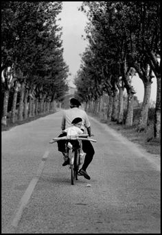 On a road of Provence, south  France, with baguettes and béret, 1955  by  Elliott Erwitt