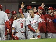 GAME 14, 4/20/12: Shane Victorino is congratulated after hitting a solo home run.