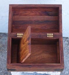 Wooden box with secret compartment under false bottom