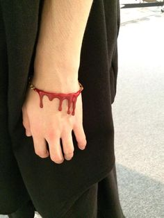 Slashed wrist bracelet. (Unknown brand)