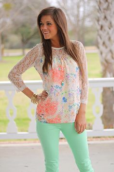 """The bright floral patterned body and lace shoulders and sleeves in this top are an unbeatable combination! The colors are bright and beautiful, and we have been loving the white lace trend this season. Slip this on with colored skinnies for a fab spring outfit!   Fits true to size. Miranda is wearing a small.   From shoulder to hem:  Small - 25""""  Medium - 25.5""""  Large - 26"""""""