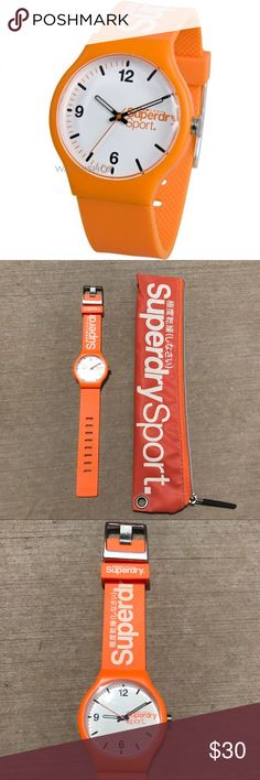 Superdry Men's Sport Watch This mens Superdry Sport watch features a vibrant design in orange, with a 40mm case set around a classic white dial. The watch fastens with a rubber strap and a buckle. Comes with zipper bag case.   **In like new condition, but batteries need to be replaced** Superdry Accessories Watches