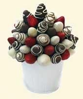 white dipped strawberries hand decorated. Special for any event