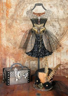 Unbeliavable Steampunk set by Maggi Harding with the outfit, hat, and altered trunk. Incredible! #graphic45