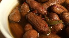 Rachael's Superheated Cajun Boiled Peanuts Recipe - Raw peanuts in their shells simmer in a salty, spicy brew flavored with crab boil, Cajun seasoning, - Peanut Recipes, Cajun Recipes, Rub Recipes, Creole Recipes, Grill Recipes, Seafood Recipes, Slow Cooker Recipes, Crockpot Recipes, Cooking Recipes