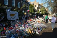 Tributes of flowers photographs and candles are left outside the home of former pop music icon George Michael in The Grove Highgate on January 5 2017...