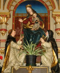 The Virgin Mary Giving the Rosary to St. Dominic and St. Catherine of Siena  Rosary Madonna by the Tyrolean sculptor, Franz Tavella, 1905, in Atzwang-Ritten, South Tyrol