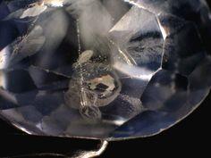 Fingerprint inclusion in a blue sapphire. Sample belongs to Far East Gem Institute, Singapore.