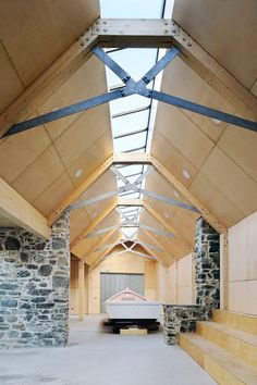 Brown + Brown transforms derelict stone buildings into boatbuilding workshop.