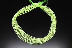 1strand  natural peridot plain ball sized 2mm by 3yes on Etsy