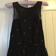 Black Dress with Small Crosses Beautiful dress with small silver crosses. Has a sheer front and a zip in the back. The dress has a stretchy waist. Cotton Candy Dresses Midi