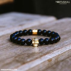 Black Onyx & 18kt. Gold Skull Bracelet by @Northskull Finished With A Unique Perforated Design