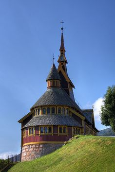 St. Olaf's Church, Balestrand, Norway. St. Olaf's Anglican Church, built in the pseudo-stave church style was completed in 1897 as a memorial to Margaret Green. Margaret, an English lady came to the fjords as a tourist to hike the mountains. She met, fell in love with and married Knut Kvikne who was an avid mountain man. Being a very pious woman, she wished for an Anglican church in Balestrand.