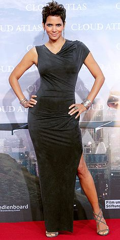 HALLE BERRY  At the Cloud Atlas premiere in Berlin, Germany, Halle may be wearing an unembellished black Helmut Lang dress, but it's anything but boring thanks to the asymmetrical hemline and high slit. That statement cuff, plus her silver danglers (both by Irit Design) and coordinating Jimmy Choo sandals, don't hurt either.
