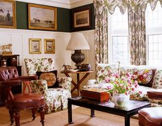 Deep wainscoting, equestrian art, unusual leather chair, floral upholstery, accessories