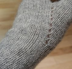 The mitt is stockinette with garter edges, decreases are SSK and K2tog, increases are YO. For me, this pattern is all about the yarn. I used a cashmere/mink yarn that had, long ago, lost its ball band. Nice pattern for that lone, beautiful lace weight skein rolling around the stash.