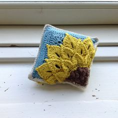 This is a quarter sunflower square designed to be paired with my quarter sunflower square from the back to make a pillow or pincushion.