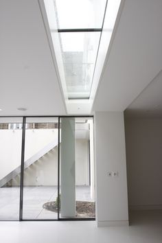 An IQ Glass walk on rooflight was situated above the Minimal… -- Article ideas / Terrace Ideas For Articles on Best of Modern Design - So many good things! Glass Roof, Interior Windows, Flat Roof Materials, Flooring For Stairs, Residential Renovations, Aluminium Sliding Doors, Roof Light, Slim Framed Sliding Doors, Minimal Windows