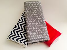 A personal favorite from my Etsy shop https://www.etsy.com/listing/294213949/nautical-themed-burp-cloth-set