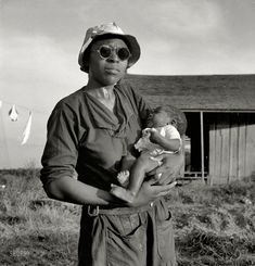 "June 1937. ""Wife and child of tractor driver. Aldridge Plantation, Mississippi.""  by Dorothea Lange."