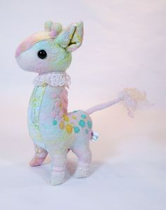 Giraffe: a mixed media fiber sculpture, made with needle felt, batik, lace, and free motion quilting by Nyssa Benthin of Lithe-Fider.