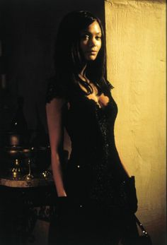"""Thandie Newton in """"Mission: Impossible II"""", 2000. The photo is too dark but I love her hair all throughout the movie."""