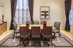 Marks and Frantz Interior Design   Elegant dining room design with light wooden table and black and white striped chairs