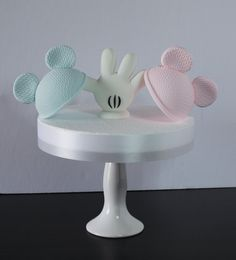 Is it Mickey or Minnie, Suspenders or Bows? Cut a Slice, To See Who Knows.  Gender Reveal Cake Topper Set, perfect for a gender reveal baby shower.  Suggested Use: Cake Topper, Table Decor.  This listing includes 1 White Fondant Mickey Mouse Glove, 1 Light Blue Knit Mickey Mouse Hats and 1 Pink Minnie Mouse Knit Hat. The glove has a bamboo skewer running up the middle with about 3 1/2 inches left exposed for you to place in your cake. The hats and glove are not attached to each other. Y...