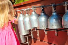 Oxygen bottle bells in the Lake Macquarie Variety Playground in NSW.  Originally Pinned by Alec Duncan of http://childsplaymusic.com.au/