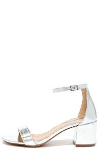 There's a version of the Babe Squad Silver Heeled Sandals for every gal in your group! These versatile vegan leather heels have a minimal upper with adjustable ankle strap, plus a low block heel. Silver buckle. #CuteDresses #TrendyTops, #FashionShoes #JuniorsClothing