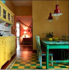 Love the yellow dresser, green table and red lamp!
