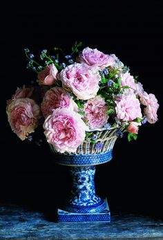 Gorgeous, English Cabbage Roses in this beautiful antique blue and white cache pot...stunning!