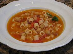 "Pasta fagioli, or pasta with beans. We Italians call it ""pasta fazool"". Chick peas with little pasta tubes in a tomato-based soup broth. I like it with less broth and more pasta and beans. So good!"