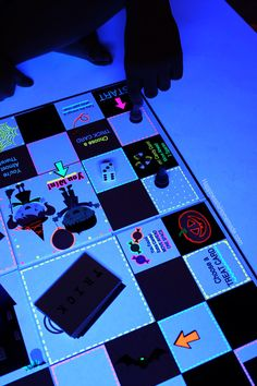 Create your own glowing board game for Family Game Night with #NeonSharpie markers! #PMedia #ad