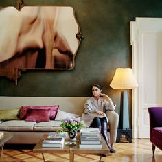 Facchinetti, in her living room, wearing clothing from her fall collection for Tod's; the couch is from the 1950s, and the pair of Dimore Studio coffee tables were made exclusively for her. Styled by Viviana Volpicella.-Wmag