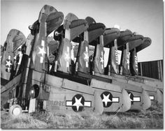 WW2 planes stored nose down awaiting scrapping.