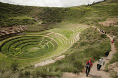 Tourists walk to the the Inca terraces of Moray near the town of Maras in Cuzco, Peru, on February 17, 2010.