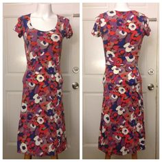 Boden Floral Dress So pretty and bright - out of a beautiful pink, purple, cream and brown floral stretchy material. *Very* slight wear on sides (like from a shoulder bag. Great overall shape. Boden Dresses Midi