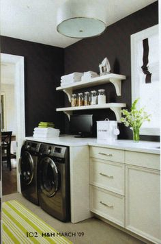 laundry room - love how the whites pop on the dark walls.