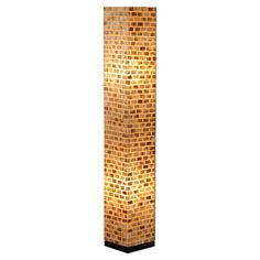Column-style floor lamp with capiz shell detail.    Product: Floor lampConstruction Material: Fiber glass and cap...