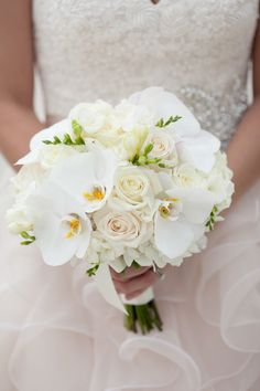 Bouquet: Ivory Roses, White Stock, Hydrangea, Freesia, Phalaenopsis Orchids | Gold & Navy Inspiration Shoot from Fabulously Chic Weddings + Jamie Lee Photography | Read more - http://www.stylemepretty.com/florida-weddings/2013/11/18/gold-navy-inspiration-shoot-from-fabulously-chic-weddings-jamie-lee-photography/