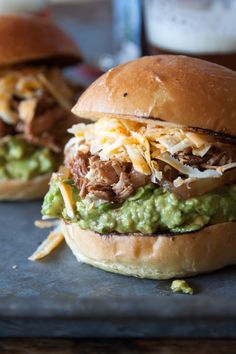Crock pot, shredded chicken and guacamole- what's not to love with this easy dinner? Foolproof Shredded BBQ Chicken Burgers