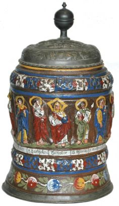 Stoneware 1 L. Kreussen Factory. Applied relief of the twelve apostles. Enameled decoration and dated 1633 at rear handle. Samuel Gunther relief pewter lid. From the Harvey Murphy collection.