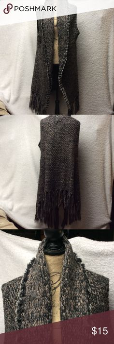 Sweater vest Beautiful sweater vest with long fringes, is a very nice fall item. Very stylish and love is amazing wth boots and jeans. Colors of blue, grays and tan-brown. Escio Sweaters
