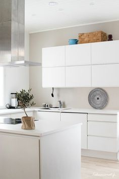Handle less white kitchen