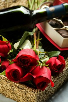Red roses, Wine bottle and Chocolates for Valentine's Day........